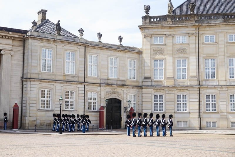 Amalienborg Palace is the home of the Danish Royal Family in Copenhagen, and where you can watch the changing of the guards ceremony.