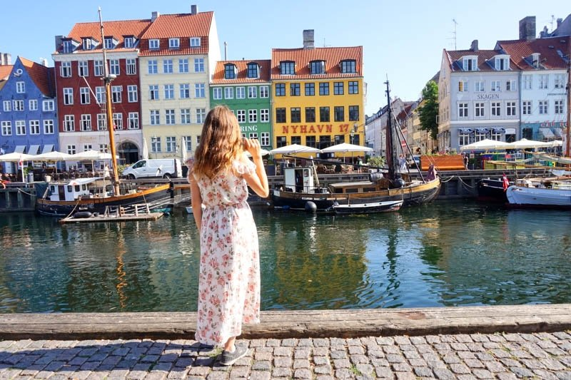Nyhavn is a popular waterfront area in Copenhagen, Denmark, lined with lots of restaurants and colourful buildings.