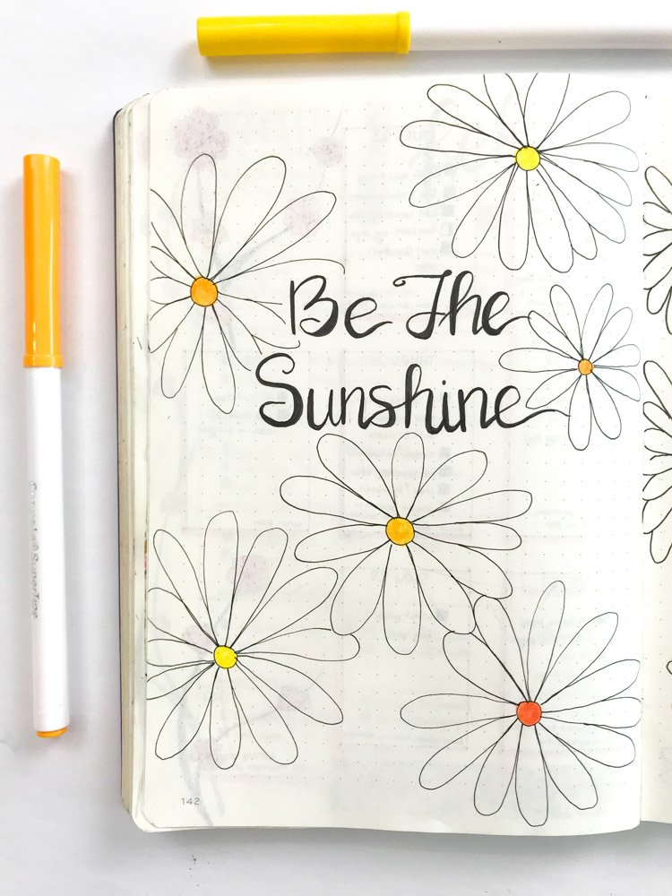daisy theme bullet journal quote page: be the sunshine in black letters surrounded by daisies