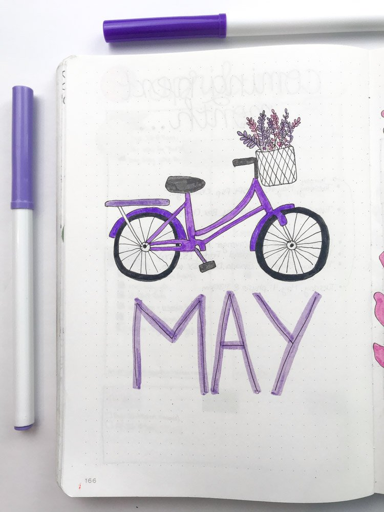 May bullet journal cover with with a purple bicycle filled with lavender