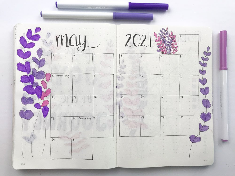 may bullet journal monthly calendar filled with lavender doodles