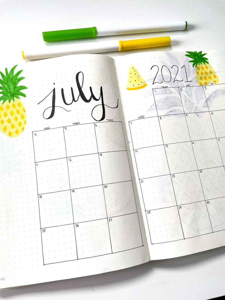 july bullet journal calendar with pineapples